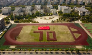 Students form the number 70 during an event in Yangzhou