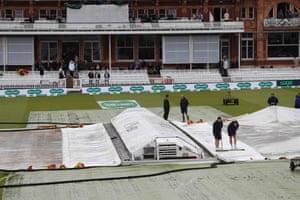 The covers protect the pitch from the rain ahead of play on the first day of the second Ashes cricket Test match between England and Australia at Lord's.