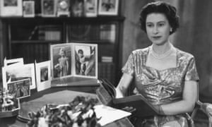 At her desk after giving the first televised Christmas Day broadcast in 1957.