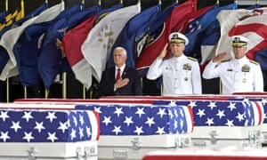 Mike Pence, left, pays his respects to the suspected remains of US troops at a base in Honolulu, Hawaii.
