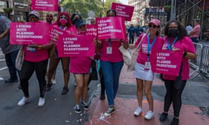 """Planned Parenthood members march in the """"Hometown Heroes"""" Ticker Tape Parade in New York City in July. Healthcare Workers, first responders and essential workers were honored for their service during the Covid-19 pandemic."""
