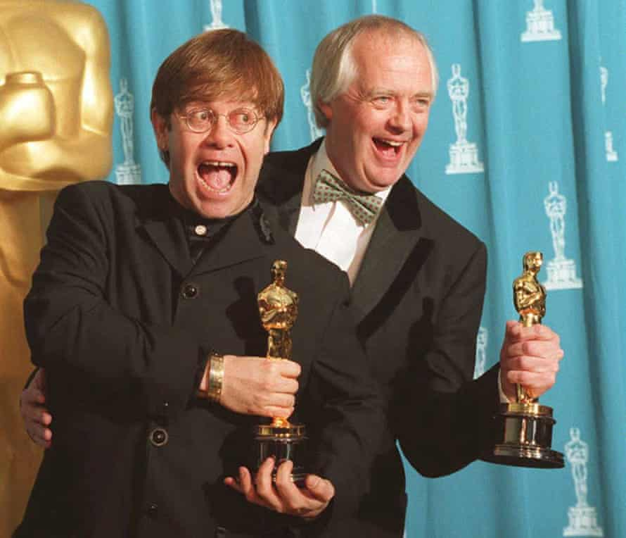 Feel the love … with Elton John at the Oscars in 1995.