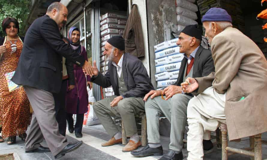 An HDP candidate, second left, canvasses in Sur district, Diyarbakir.