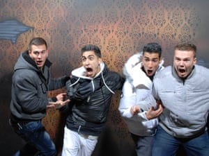 Visitors at the end of their trip to Nightmares Fear Factory, a haunted house attraction built on the site of a former coffin factory in Canada.