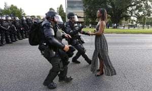 Standing tall: Ieshia Evans is detained by law enforcement officers as she protests the shooting death of Alton Sterling near the headquarters of the Baton Rouge Police Department in Louisiana.