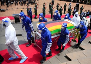 Pallbearers carry a coffin at the burial of two cabinet ministers and a retired general who died after contracting the coronavirus disease (COVID-19) in Harare, Zimbabwe