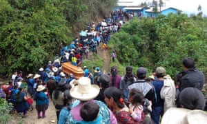 Hitler Rojas Gonzales's coffin is carried by local residents in Peru's Cajamarca region, after he was shot on 28 November in his hometown Yagen.
