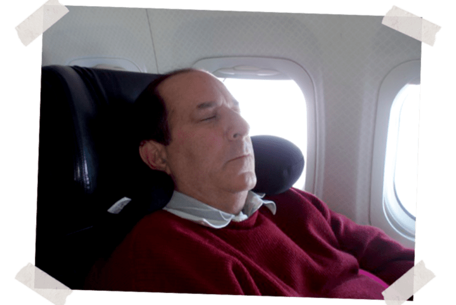 Dad asleep in seat 1A, the left-hand front seat, early 2000s.