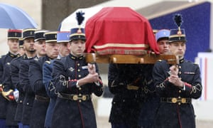 Arnaud Beltrame's coffin is carried during the ceremony at the Hotel des Invalides in Paris.