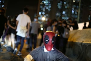 An anti-government protester in a Deadpool mask.