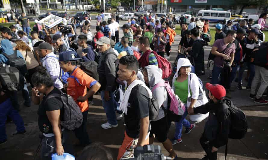 Migrants start their journey to the United States in San Salvador, El Salvador.
