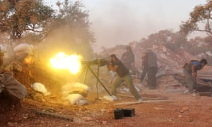 A rebel fighter fires heavy machine gun during clashes with government forces in of Syria's Idlib province.