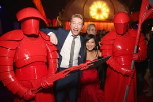 Actor Domhnall Gleeson (2nd from L) and Kelly Marie Tran (2nd from R) pose with the Praetorian Guard at Star Wars: The Last Jedi Premiere at The Shrine Auditorium