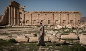 A Syrian man walks on the ruins of the Temple of Bel, an ancient stone ruin in Palmira, Syria, Saturday March 22, 2014
