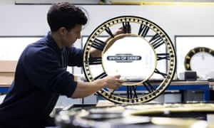 An apprentice tends to a clock frame at Smith of Derby Clockmakers