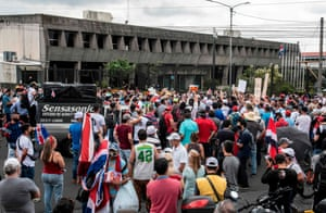 People take part in a protest in rejection of austerity policies promoted by the government to contain public spending amid the coronavirus pandemic, in front of the presidential house in San Jose, Costa Rica on 25 August 2020.