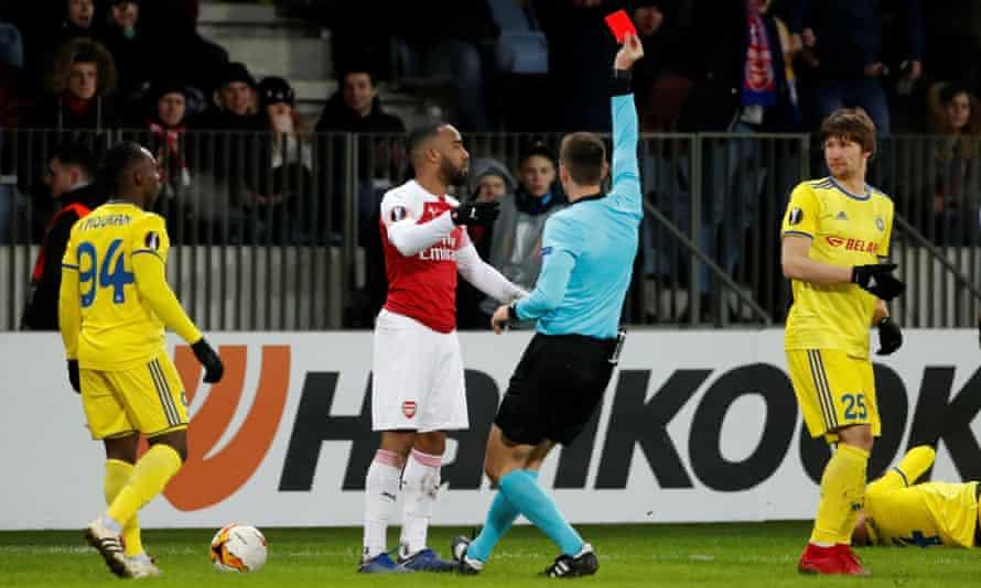 Arsenal's Alexandre Lacazette is shown a red card by referee Srdjan Jovanovic for an elbow on Aleksandar Filipovic of Bate Borisov