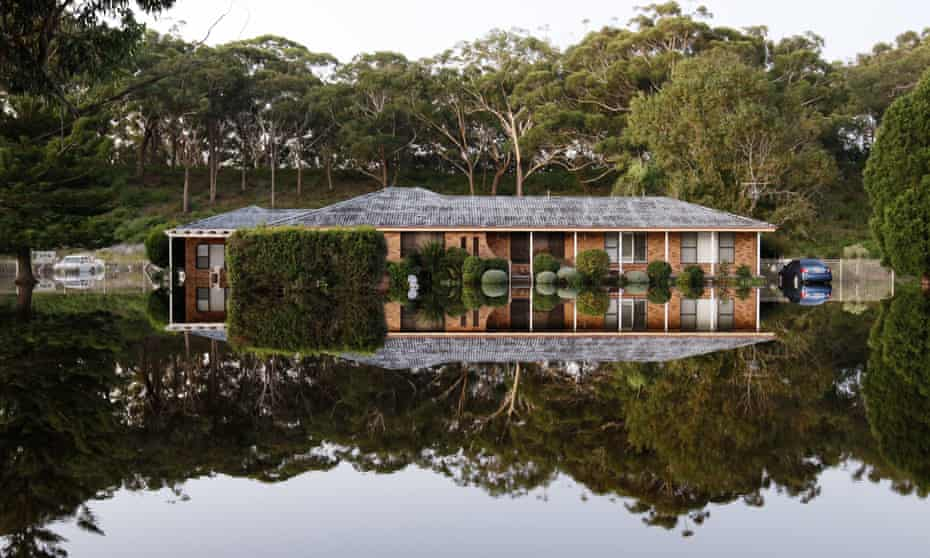 A house surrounded by flood water in Port Stephens, Australia
