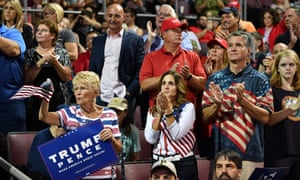 """Supporters of US President Donald Trump attend a """"Make America Great Again"""" rally at Erie Insurance Arena on October 10, 2018, in Erie, Pennsylvania. (Getty Images)"""