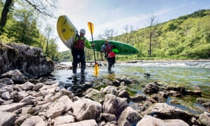 Kayakers on the River Wye in Herefordshire, where a drought has caused low water levels that threaten this year's salmon run.