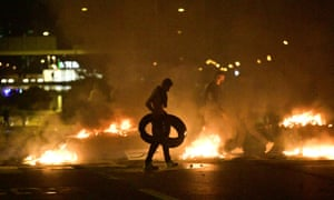 Demonstrators burn tyres during clashes with police in Malmö on Friday.