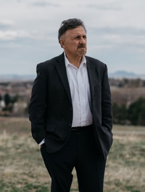 Frank DeAngelis poses for a portrait at the Columbine memorial in Littleton, Colorado.