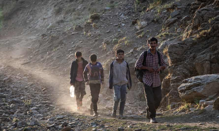 Migrants from Afghanistan walk along a mountain pathway to reach Tatvan in Turkey last month.