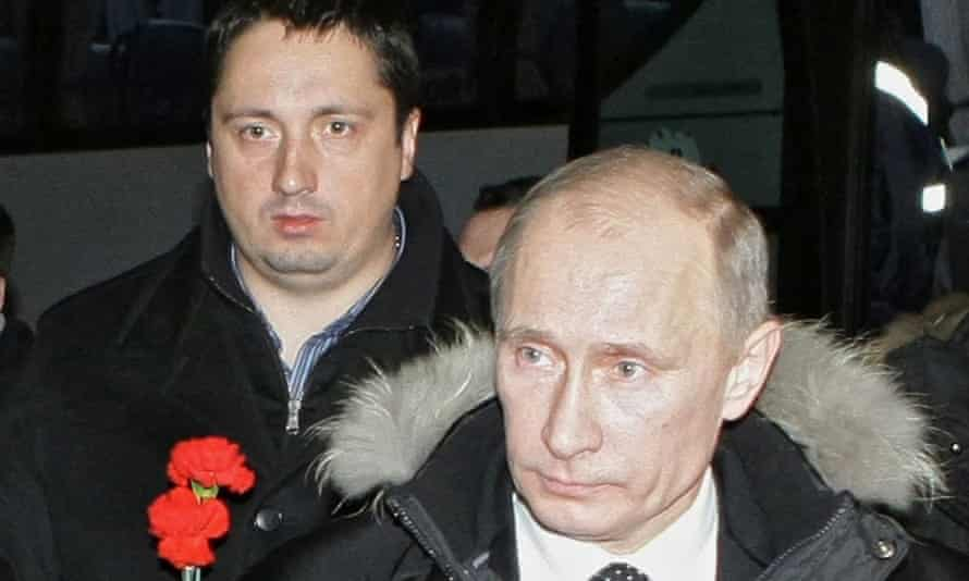 Alexander Shprygin and the Russian prime minister Vladimir Putin prepare to lay flowers at the grave of a Spartak Moscow fan.