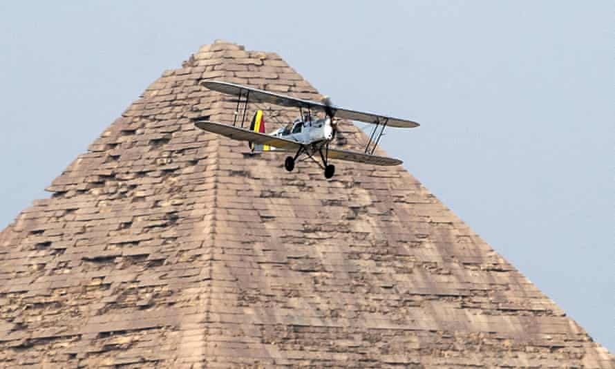 A Stampe OO-GWB biplane is flown over a Giza pyramid by Yasser Menaissy and Cedric Collette last week in the Vintage Air Rally.