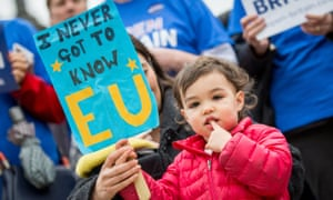 A child holds a placard as Open Britain gather on Parliament Square to demonstration against Brexit and the triggering of Article 50.