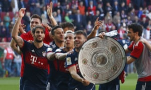 Bayern Munich players celebrate the title – with a replica of the Bundesliga trophy.