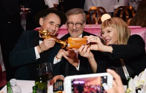 Mark Rylance, winner of the award for best actor in a supporting role with director Steven Spielberg and his wife Kate Capshaw at the Governors Ball after the Oscars