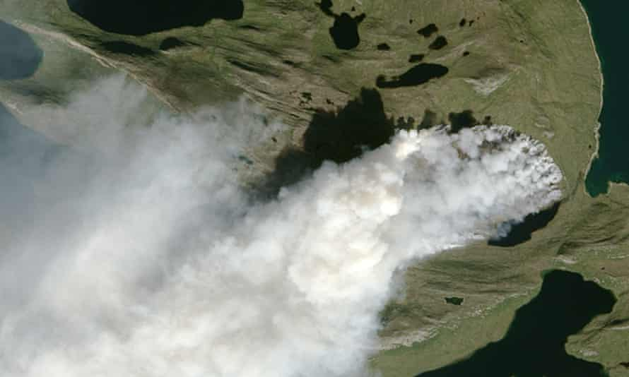 NASA Earth Observatory image by Jesse Allen, using Landsat data from the US Geological Survey, shows a wildfire in Greenland.