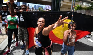 Indigenous protesters march through central Brisbane on 'Invasion Day' (Australia Day) in January.
