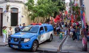 Rio's City Police Force keep watch over revellers on the Selaron Steps