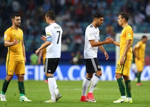 Bailey Wright, Julian Draxler, Emre Can and Trent Sainsbury shake hands at the final whistle.
