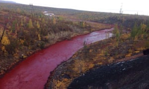 The red Daldykan river in Norilsk, Russia