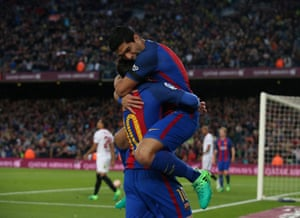 Suarez thanks Lionel Messi who provided the ball in.