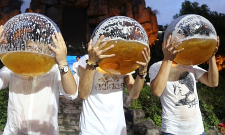 People drink beer from fish bowls at a beer drinking competition in Hangzhou in China.