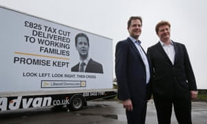 Nick Clegg stands with Danny Alexander at a poster launch event in Hyde this morning
