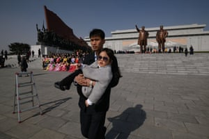 A man carries a child after visiting the statue complex