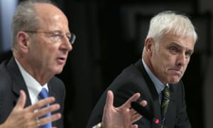 Hans Dieter Pötsch, chairman of the board of directors of Volkswagen, left, and Matthias Müller, chief executive, right.