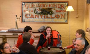Visitors enjoy beers at the Cantillon brewery in Brussels. The brewery follows traditional way to brew lambic style beers but this is at risk with warmer weather.