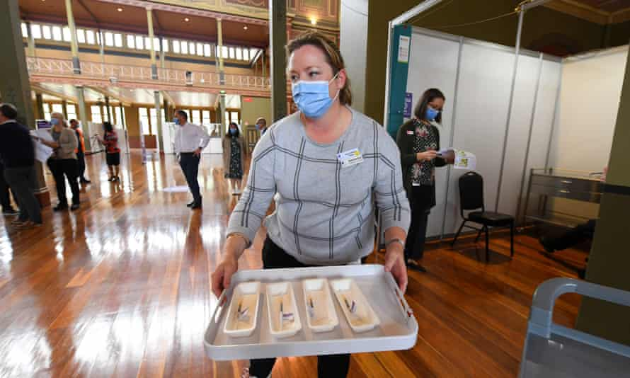 A healthcare worker transports Covid-19 vaccinations to injecting rooms inside of the Royal Exhibition Building in Melbourne in March.