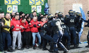 Riot police clash with striking prison guards blocking access to the Baumettes prison in Marseille