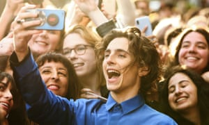 Actor Timothee Chalamet takes a selfie with fans at The King film premiere in Sydney.