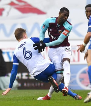 West Ham's Pedro Obiang is tackled by Wigan's Max Power injuring his knee at the DW Stadium. Wigan won the game thanks to a brace from Will Grigg.