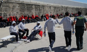 Migrants at the port of Tarifa after being taken from dinghies off the coast in the Strait of Gibraltar.