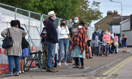 People queue for a test at a walk in Covid-19 testing facility in Southend on Se.