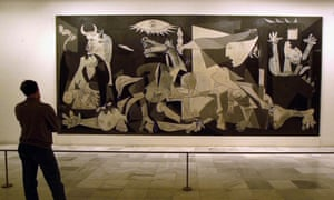 A person views Spanish artist Pablo Picasso's world famous painting Guernica at Madrid's Reina Sofia museum, Spain, April 2000.